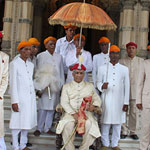 HH Maharaja Samarjitsinh Gaekwad with the royal umbrella held over his head