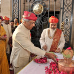 Yuvraj Samarjitsinh along with his wife offering prayers at the palace main gate